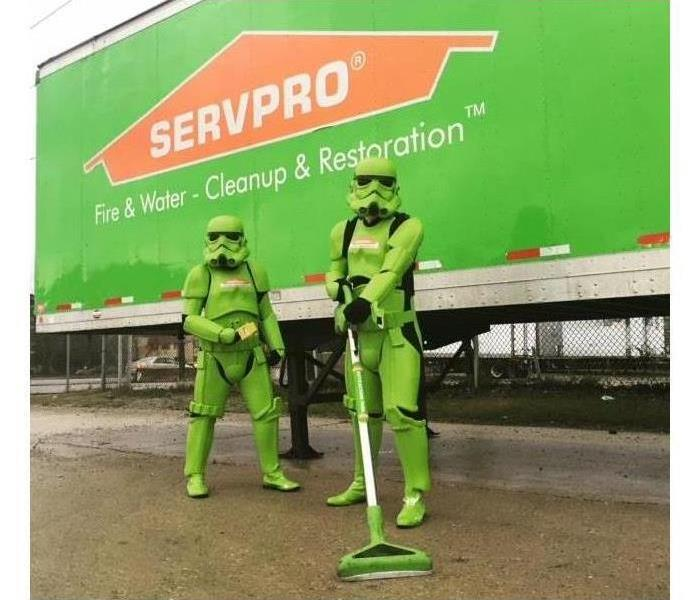 2 green SERVPRO Storm Troopers